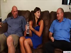 Two old guys are screwing a slender young babe on the sofa