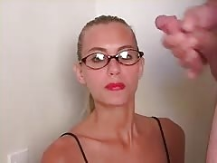 Very elegant bitch is getting a huge dose of cum on her face
