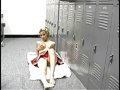 Busty cheerleader pornstar is having fun with herself in the locker room