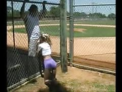 Metal fence is not a barrier for this cock-sucking slut