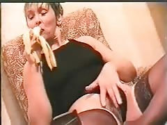 Dirty russian milf is spreading her legs and eating banana