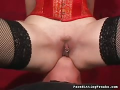 Sensual Domina in black stockings getting pleased by slave