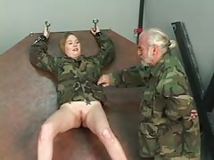 Soldier girl with shaved pussy is restrained by Master Len for interrogation